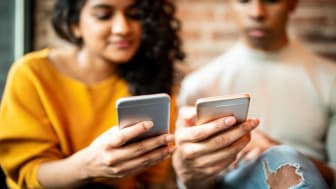 picture of two people with their phones close together