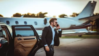 picture of a rich guy getting out of a limo in front of a private jet