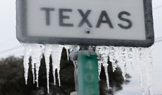 """picture of road sign saying """"Texas"""" covered in ice"""