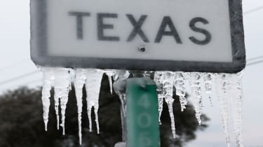 "picture of road sign saying ""Texas"" covered in ice"