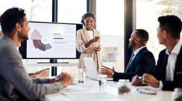 Businesswoman delivering presentation in boardroom