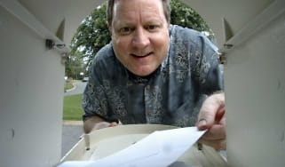 photo of man opening mailbox