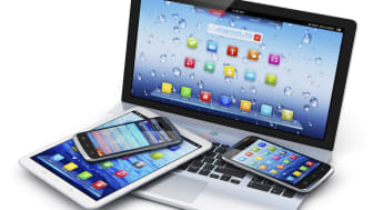 Mobile devices, wireless communication technology and internet web concept: business laptop or office notebook, tablet computer PC and modern black glossy touchscreen smartphones with colorfu
