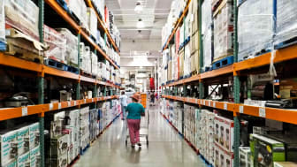 a female shopper walks the aisles of warehouse retailer COSTCO