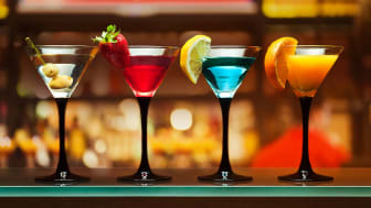 Colorful martinis on a bar.