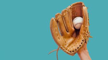 Catching a baseball in a mitt.
