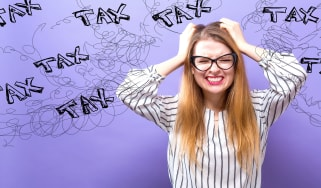 picture of woman stressed out by taxes