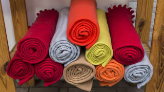 A stack of fleece blankets.