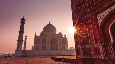 Taj Mahal in India taken at dawn / sunrise by the mosque
