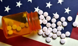 Prescription pill bottle on American flag