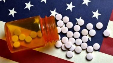 Prescription pill bottle on American flag