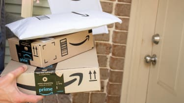 Closeup of boxes and packages from Amazon being delivered