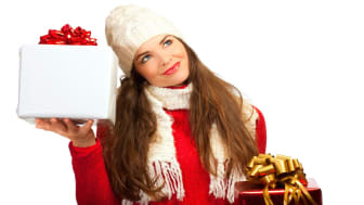 Beautiful young woman deciding what christmas present to buy