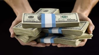 picture of hands holding stacks of cash