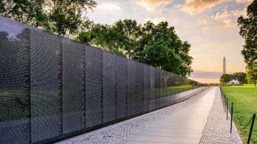 The Memorial Wall of the Vietnam Veterans Memorial in Washington DC at dawn.