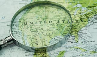 A shot of magnifier glass over map. Looking, searching, research information and traveling