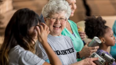 A volunteer helps sort through canned goods