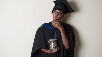 Photo of college grad holding money and thinking