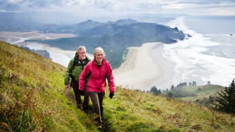 Senior couple hiking in the hills above the Oregon coastline