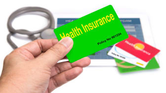 picture of a hand holding a health insurance card