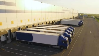 trucks waiting at loading dock