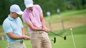 Two friends paying golf