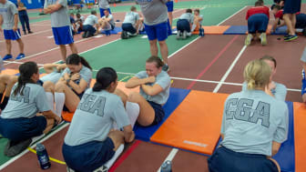 picture of female Coast Guard Academy cadets doing sit ups