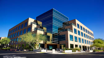 Scottsdale Arizona business building on a clear day with set on a bright blue clear sky background