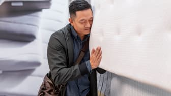 Man shopping for a mattress in a store