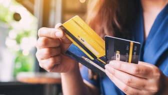 A woman holding several credit cards
