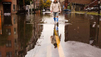 Photo of person walking on flooded street