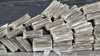 stacks of folded paper money worn and worn out, ready for disposal and destruction