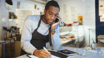 man on telephone in place of business