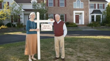 Couple on lawn of house for sale