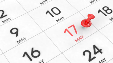 picture of a calendar with a red pin stuck in the box for May 17