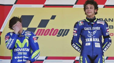JEREZ, SPAIN - APRIL 10:Race winner Valentino Rossi of Italy and Yamaha stands on the podium beside a disappointed 2nd placed Sete Gibernau (L) of Spain and Honda and 3rd placed Marco Melandr