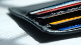 Close Up Of Multiple Credit Cards In Leather Wallet
