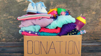 picture of a box full of clothes to be donated