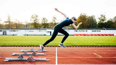 A woman sprints out of the starting blocks