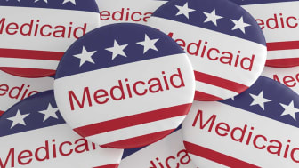 """picture of buttons saying """"Medicaid"""" on them"""