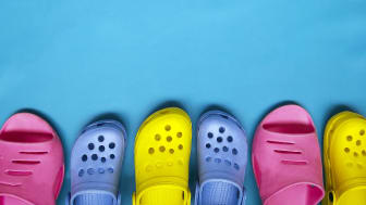 Three pairs of Crocs shoes