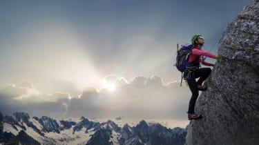 A person climbing a mountain