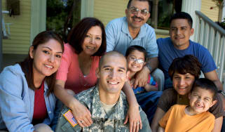 A military family posing for a picture.