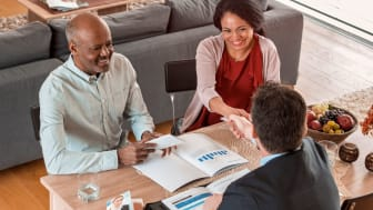 A couple meeting with a financial planner