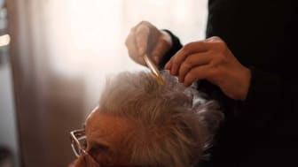 picture of elderly woman getting her hair combed