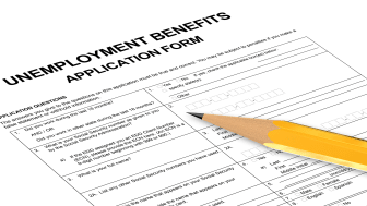 picture of an unemployment benefits application form with a pencil on it
