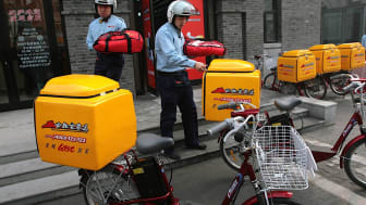 NANJING, CHINA - JANUARY 18: (CHINA OUT) Employees carry delivery containers to their bicycles during an opening ceremony of Pizza Hut Delivery on January 18, 2007 in Nanjing of Jiangsu Provi