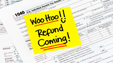 """picture of post-it that says """"Woo Hoo, Refund Coming"""" on a tax form"""