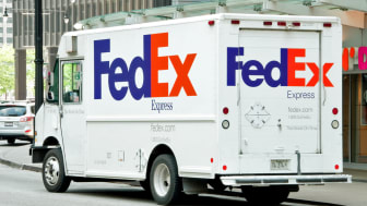 ?hicago, USA - June 24, 2013: A FedEx truck stopped on Hubbard and Wabash Avenue making deliveries to a local business mid morning.