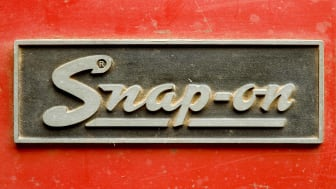 A close-in shot of a dusty, slightly worn Snap-On logo on one of its products